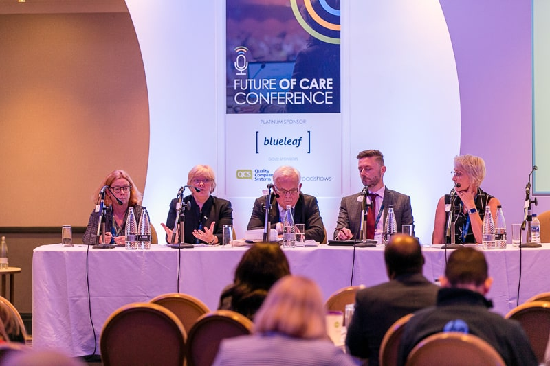 A panel of experts hold a conference at a Care Roadshows event